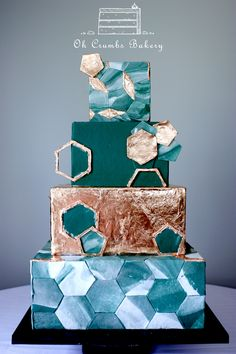 Green marble geometry tile wedding cake with copper accents.