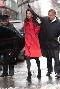 Amal Clooney braves the snow storm in bright red.