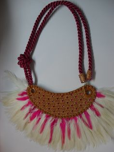This necklace is in colors of fuchsia, the main part is had decorated leather by patter, metal components and gemstones.  for sale on FB account La Mode de Boheme