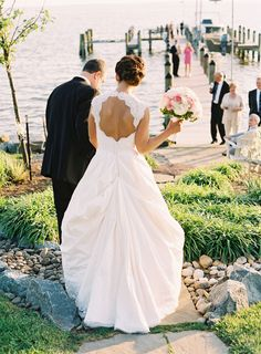 BUSTLE!! Photography: Adam Barnes Fine Art Photography - adambarnes.com/  Read More: http://www.stylemepretty.com/little-black-book-blog/2014/01/23/preppy-chic-waterfront-backyard-wedding/