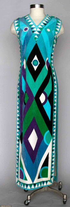 "Pucci Velvet Beach Cover, 1970s, Augusta Auctions, Velvet toweling w/ geometric print in green, purple, aqua, & black, different pattern front & back, V neck, straight lines w/ open sides, label ""Emilio Pucci Florence Italy"