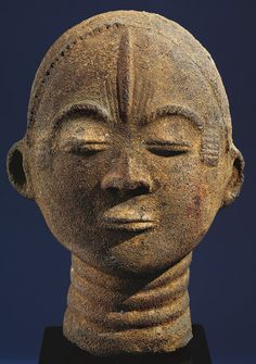 Memorial Head, 17th century Ghana; Akan, Twifo region, Hemang city Terracotta, roots, quartz fragments