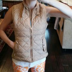 Beige quilted padded vest with fur lining NWT Beautiful quilted vest. .has faux fur lining. .2 pockets in the front and snaps in the back to adjust waist! perfect to wear while hiking,  outdoor activities or just casual wear.. looks way better in person. .New with tags attached!  No trades  (I'm modeling the size small) boutique  Jackets & Coats Vests
