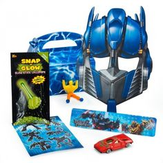 """Transformers Party - this site has some good ideas as well as a link to a site called DLTK (unfortunately, no pics so I can't pin directly to it) that has games ideas and invitation wording. I like the idea of a """"stretchy strong man"""" in the party favor bag."""