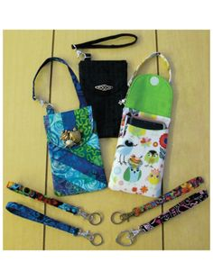 "Phone Fob Pockets Sewing Pattern. Includes full-sized pattern pieces and instructions to make a wristlet phone fob, wristlet key fob and a phone fob pocket with a strap to hook to your purse or backpack. Finished size of the phone pocket is 3 3/4"" x 5 7/8"" with instructions for making it bigger if needed."