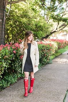 what to wear on a rainy day - Neutral Trench Coat + Striped Dress + Red Hunter Boots