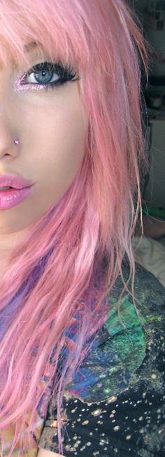 Light pink hair and sparkly pink on the inside corner of the eye.