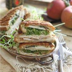 This turkey cheddar apple butter panini is the perfect fall lunch. Pressed until the cheese is super melty with crisp apples, sage and fresh turkey, it's like fall in a bite.