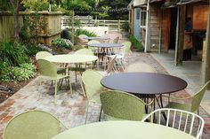 A collection of Fermob furniture at Sudbury near Wellington UK. Russet tables, Willow Green and Nutmeg Rendez-vous chairs and Cotton White Flower chairs Willow Green, Outdoor Furniture Sets, Outdoor Decor, Outdoor Settings, White Flowers, Photo Galleries, Patio, Gallery, House
