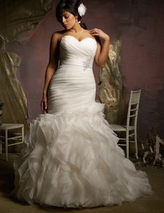 Gorgeous hand ruched, mermaid style gown with sweetheart neckline, beaded belt and corset tie up back. The trumpet style bottom is layers of gorgeous tulle with floor-length train. Absolutely stunning