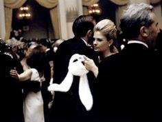 Candice Bergen taking a break from her mask whilst dancing at Truman Capote's Black and White Ball, in the Grand Ballroom of New York City's Plaza Hotel, NYC, November 28, 1966