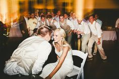 Bride and groom share a moment before the garter toss! Beautiful wedding at the Waco Arboretum Pavilion. Lighting and music by #leforcedj