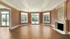 Living room with orange walls Wood Flooring Options, Solid Wood Flooring, Laminate Flooring, House Painting Cost, Cherry Wood Floors, Cheap Tiles, Best Laminate, Domestic Cleaning, Orange Walls
