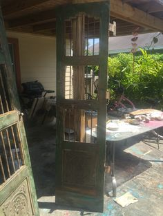 Old Mexican doors needed wood added to bottom. The new wood was painted to match by Holly Blanton Art.