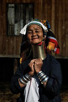 Women of the various Kayan tribes identify themselves by their different form of dress. The Kayan Lahwi tribe are the most renowned as they wear ornaments known as neck rings, brass coils that are placed around the neck. The women wearing these coils are known as giraffe women to tourists. These coils are first applied to young girls when they are around five years old.  Each coil is replaced with longer coil, as the weight of the brass pushes the collar bone down and compresses the rib…