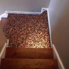 If you can't pave the streets with gold, pennies are an affordable substitute! Armed with adhesive, lacquer, grout, and a collection of pennies, the creative mind at The House of Bing turned a mundane staircase into a glittering copper corrider. Check it out right here.