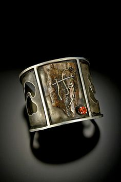 Cuff   Bond Blackman.  'Golden Falls' Sterling silver, inlaid gold wire, 10,000 year old Mammoth Ivory, 14k gold, sapphire.