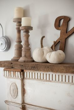 Our process for how to mount an antique mantle to our fireplace to add an antique flare to our living room. | DIY Mantle | How to Make Your Own Mantle | DIY Mantle Tutorial || Lauren McBride