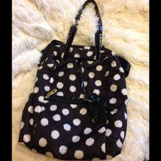 Betsey Johnson Black & White Polka Dot Bag Adorable polka dot bag. Has straps to carry as a handbag and also straps on backside to carry as backpack. Lots of pockets. Inside very clean. Outside has no spots nor tears. White dots are slightly dimmed from wear. Material can be washed so may be able to brighten. Overall good condition. Super adorable! Measures approx 15x18 lying flat. Betsey Johnson Bags Backpacks