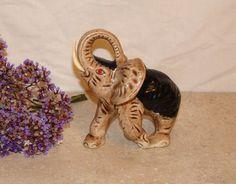 Elephant / Lucky / Raised Trunk Tusk / Ceramic Figurine / Brown Black Red / Detailed. $24.00, via Etsy.