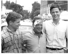 Three bandaged activists:(left to right) Rabbi Arthur J. Lelyveld (Cleveland, Ohio), a minister with the Hattiesburg Ministers Project, and voter registration volunteers David Owen (Pasadena, California; a student at Oberlin College) and Lawrence Spears (Palo Alto, California; a student at Stanford University) on July 11, the day following their assault. They are standing in the 600 block of Mobile Street near Freedom Summer headquarters at 507 Mobile Street.