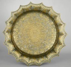 Basin, early 14th century.  Western Iran.  Brass inlaid with silver and gold, champlevé engraving. | The Metropolitan Museum of Art