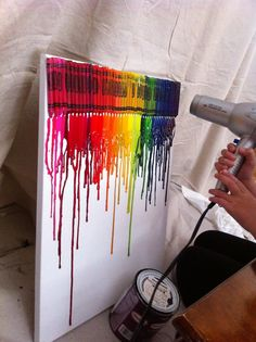 crayons glued to a canvas and blow dry it