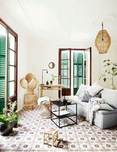 SHUTTERS Bright boho room with green shutters and patterned tiles