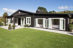 Windows and french doors - Matakana Design and Build - Painted board and batten exterior cladding. Cedar Cladding, Exterior Cladding, Board And Batten Exterior, Board And Batten Cladding, Shed Homes, House Painting, Inspired Homes, Black House, House Colors