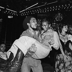**Bob Marley** & Sandra Kong, Night Club 'Chez Regine', Paris, France, May 10, 1977. Party for Bob after the Paris Show at the Pavillon Baltard. More fantastic pictures, music and videos of *Robert Nesta Marley* on: https://de.pinterest.com/ReggaeHeart/