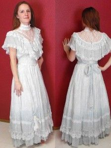 I had one very similar, cream with pink flowers, long lace sleeves, and the ruffle was lace. I want to find it again and make a doll dress out of it.