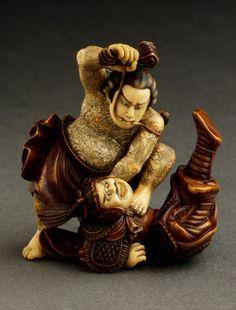 "Netsuke ~ Kyūmonryū Shishin from the Chinese Novel ""Suikoden"" ~ Ivory with deep staining, sumi ~ Shūkōsai Anraku (Japan, active early to mid-19th century) Japan, early 19th century"