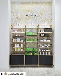 Brass shelving makes this space! Amuneal and Calico Wallpaper