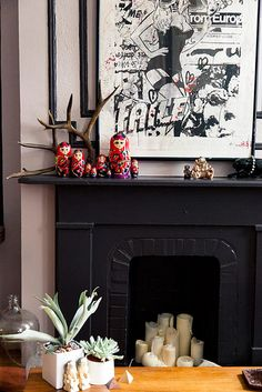 Gretchen Jones Brooklyn Apartment as shot by Design Sponge with items from www. love the candles in the fireplace Candles In Fireplace, Black Fireplace, Faux Fireplace, Fireplace Mantle, Fireplaces, Unused Fireplace, Fireplace Decorations, Fireplace Ideas, Foyers