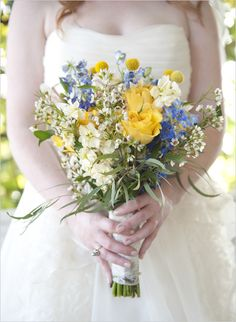 pretty bouquet in wedding colors- i like the blue and yellow