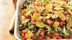 Tasty taco ingredients combine in this easy casserole topped with crunchy tortilla chips.