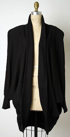 This is a cotton jacket by American designer Norma Kamali. Kamali is known for making fashionable knit designs such as this one. This one is from 1982.