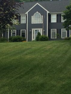 Sherwin Williams Peppercorn with downy white trim and black shutters