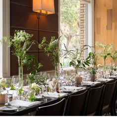 Not everyone has space for seated dinner. Rebecca softened commercial flatware and stemware from this restaurant with curling vines at various heights and pretty calligraphy. Photo by Adam Kuehl.       - TownandCountryMag.com
