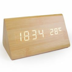 JCC Wooden Series Modern Mini Triangle Wood Grain Thermometer Touch Sound Activated Desk LED Digital Alarm Clock (Powered by: Battery / USB / DC) (Bamboo-White) JCC http://www.amazon.com/dp/B00NGEJM56/ref=cm_sw_r_pi_dp_APzdvb13JW238