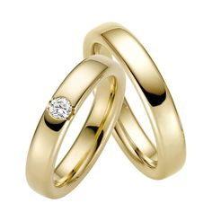 The symbol of your love and commitment crafted in the most refined way is set in 14K Yellow Gold.  Classical set, the pair with its luminous diamond in the center is a diachronic choice.  The Women's style band has 1 diamond in the center (0.03 ct) The Men's style band is plain. The width of each band is 5mm.  (Diamond Clarity: SI1 - Color: H - Pair Gold Weight: 11grams).  Available in 18K & in Platinum.