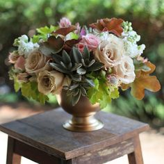Centerpiece with Star Blush spray roses, Quicksand roses, blushing bride protea, white stock, caramel Heuchera, lime Heuchera and Kalanchoe ...