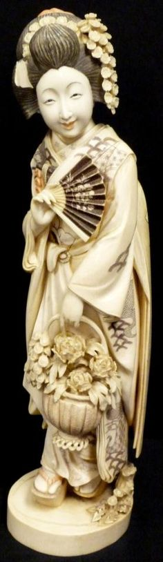 Japanese ivory okimono of a maiden with a basket of flowers, signed to base in red cartouche, Meiji era
