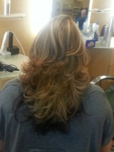 Short layered haircut with multiple high and low lights