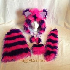 This set includes: Hat, fluffies tail, and wrist cuffs.  Made with top quality faux fur.  Pink and purple layer set.  Hat -  Back half of hat is