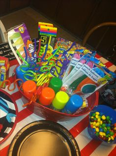Boys sleepover birthday party... Instead of gift bags I got lots of goody's and had them out for the boys to play with that night!!!