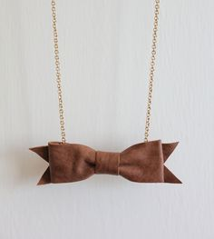 Bow Tie Necklace Handmade Using Soft Brown Leather. £15.00, via Etsy.