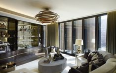 One Hyde Park, LondonThis half of the Formal Reception room is centred around a stunning bar area finished in moon gold-leaf mirror which provides the perfect area for entertaining.