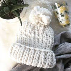 - CHUNKY KNIT WHITE POM HAT - Snowflake white and oh so cozy this hat is perfect for snowy winter walks! ❄️ Wear with an oversized scarf and booties for the perfect cozy winter vibe. 100% acrylic, can be worn rolled up or unrolled for a slouchier look. NWT comes in original dust bag. 🎄🎁 Perfect stocking stuffer! Model pics for size reference only - hat is white! 🛍Bundle & Save 20% on 2+ items! 🙅🏼No trades / selling off of Posh.  ✨Offers always welcome!✨ Claire Louise Boutique…