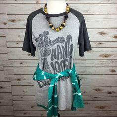 """[Lucky Brand] Hang Loose Graphic Tee Vintage  Boho Super soft vintage Lucky Brand graphic tee shirt. Oversized fit, like your favorite boyfriend tee. Baseball style sleeves. I like to pair these with leggings and a kimono or flannel.  Fabric: 80% Cotton 20% Polyester  Size: XL (Mannequin is a small for reference) Bust: 20"""" Length: 26"""" Condition: GUC. Graphic has faded distressed look/textured. Soft & slightly fuzzy fabric.  No Trades! Lucky Brand Tops Tees - Short Sleeve"""